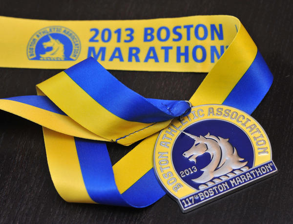 The medal given to Kathryn Ledwell, after completing the 2013 Boston Marathon. Ledwell, 22, a Johns Hopkins University senior studying piano at the Peabody Institute, had completed the Boston marathon shortly before the bombs exploded that killed three bystanders and wounded more than 170 people.