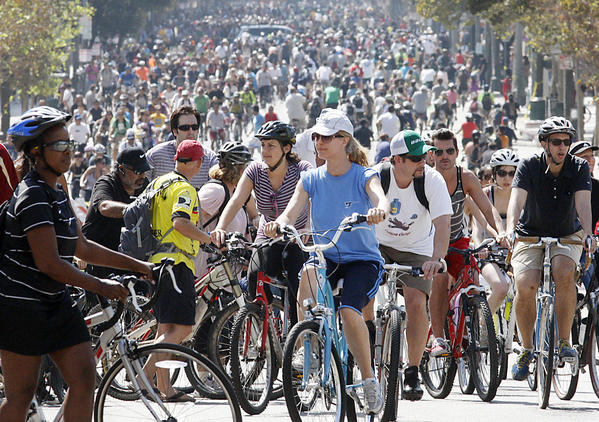 Thousands of bicyclists pedal up and down Spring Street in downtown Los Angeles during CicLAvia last year.
