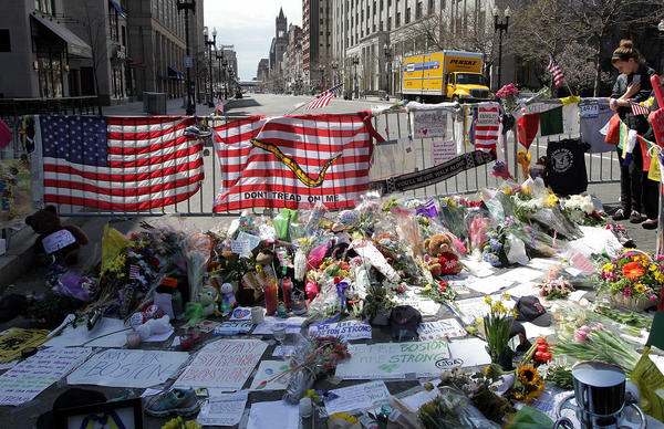 A memorial takes shape on Boylston Street in Boston, Mass.