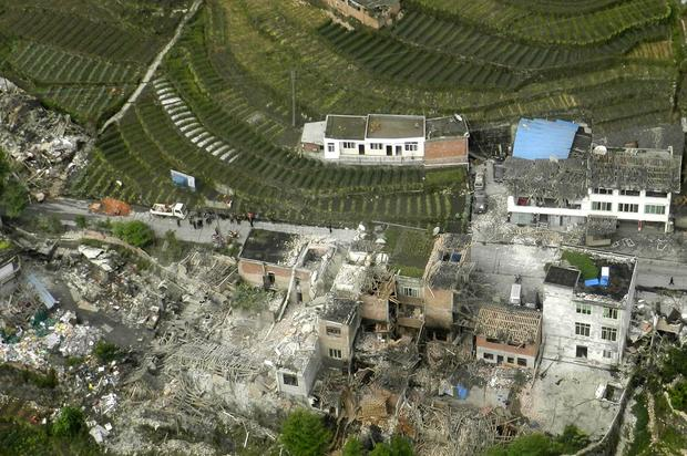 This aerial photo released by China's Xinhua news agency shows destroyed houses after a powerful earthquake hit Lushan County's Ya'an City in China's Sichuan Province. The powerful earthquake jolted the province near where a devastating quake struck five years ago.