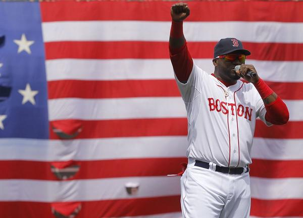 Boston Red Sox's David Ortiz addresses fans during a pregame ceremony honoring the victims of the Boston Marathon bombings.