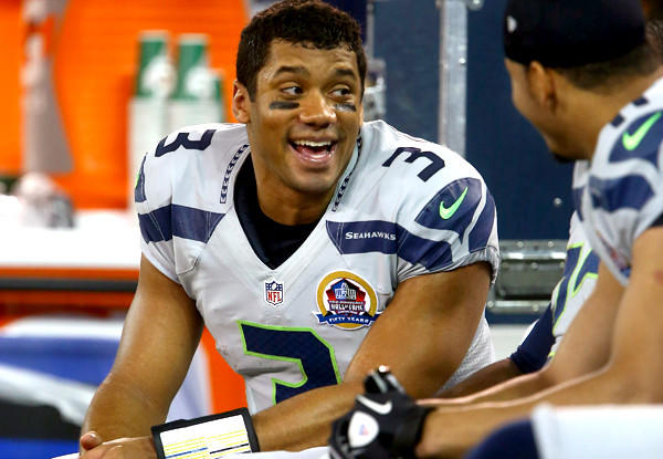 Seahawks quarterback Russell Wilson chats with teammates during a rout of the Buffalo Bills last season.