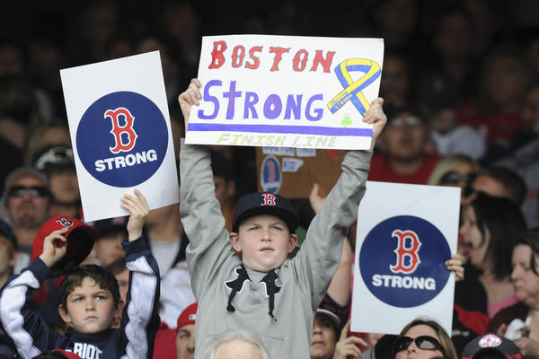 Fans hold Boston Strong signs during the fourth inning of a game between the Boston Red Sox and Kansas City Royals at Fenway Park Saturday.