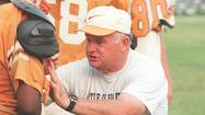 Hovis, who coached Tabb to three state football titles in 24 seasons, died Saturday morning after battling heart and kidney ailments for several years. He was 78.