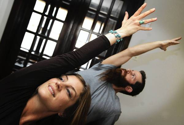 Stephanie and Chris MoDavis practice yoga in their new studio, YogaMos. YogaMos is located at 410 Main Street in Hellertown.