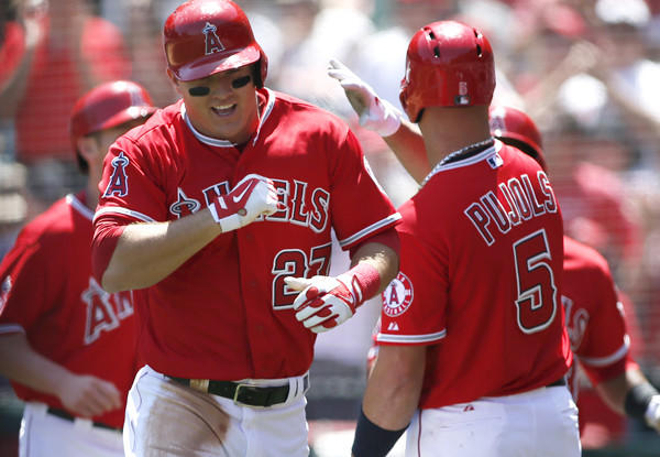Angels left fielder Mike Trout is congratulated by first baseman Albert Pujols after hitting a grand slam against the Tigers in the first inning Saturday afternoon.