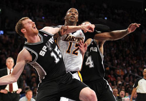 Dwight Howard, Matt Bonner and Danny Green battle for position during the fourth quarter of the Lakers' 91-86 win over the San Antonio Spurs.