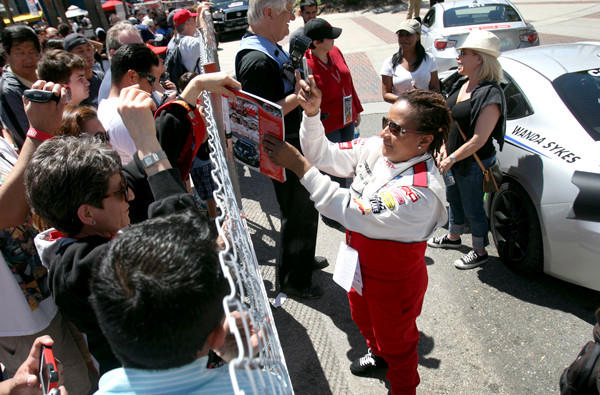 LONG BEACH, CA. --APRIL 19, 2013: Comedian Wanda Sykes signs autographs after racing in the Toyota Pro/Celebrity event on Saturday in Long Beach.