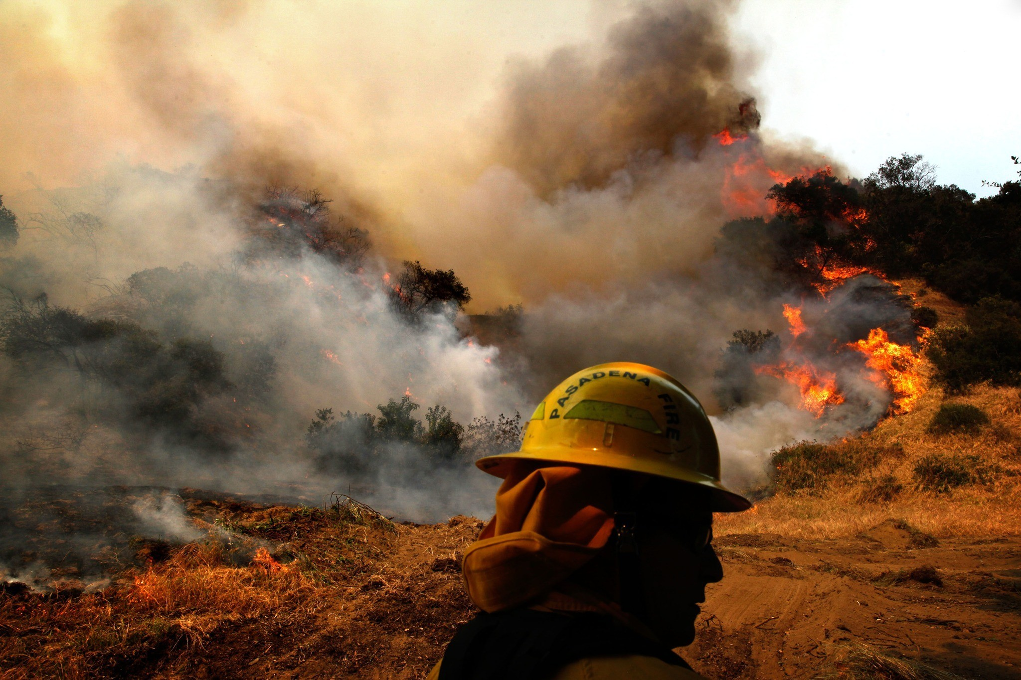Fire in Monrovia - A firefighter looks over a raging fire