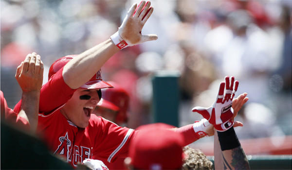 Mike Trout celebrates with his Angels teammates after hitting his first career grand slam Saturday against Detroit.