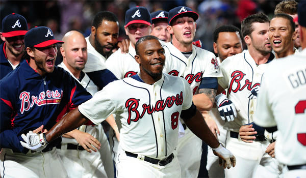 Justin Upton is congratulated by his Braves teammates after a game-winning home run against the Chicago Cubs on April 6.