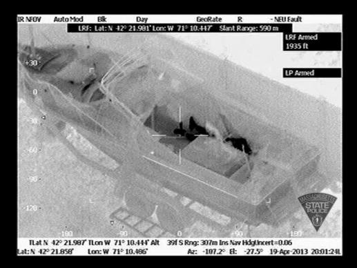 In this handout provided by the Massachusetts State Police, the boat in which Boston Marathon bombing suspect Dzhokhar A. Tsarnaev was hiding is seen from the Forward Looking Infrared setting of a police helicopter on Franklin Street in Watertown, Mass., Friday. He was apprehended on the boat parked on a residential property.