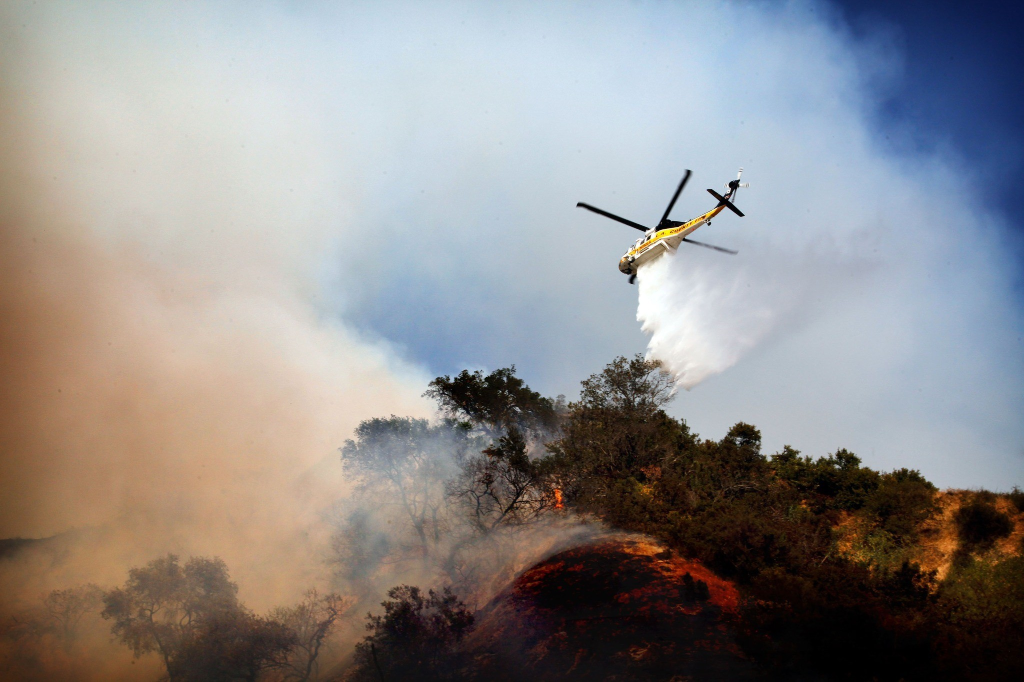 Fire in Monrovia - A helicopter drops water