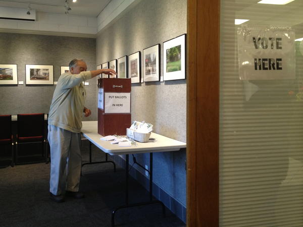 Wilde Lake resident Eddie Lucero casts his vote during the 2013 Columbia Association elections. In Wilde Lake, Nancy McCord defeated incumbent Regina Clay in the Columbia Council election.