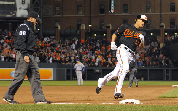 Orioles' Manny Machado circles the bases after his three-run homer in the sixth inning.