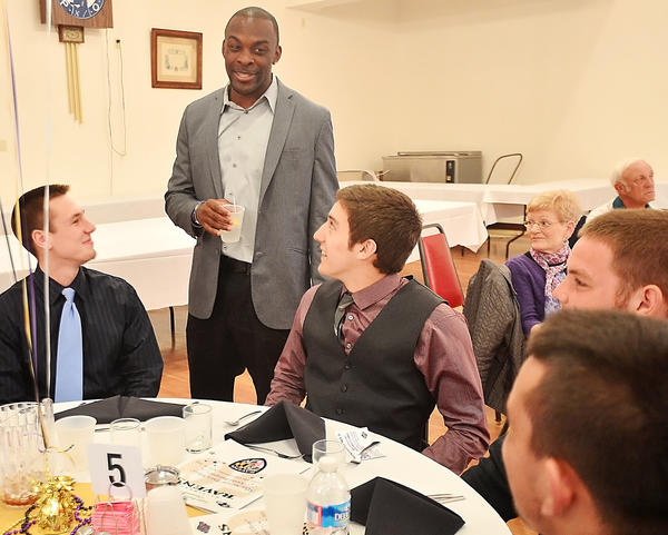 Baltimore Ravens cornerback Corey Graham talks with members of the Boonsboro football team during the Ravens Roost No. 7 Extra Effort Awards Banquet at the Elks Lodge in Hagerstown.