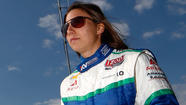 Simona De Silvestro holds out her hands to show there's hardly a sign that they were seriously burned in a racing crash two years ago.