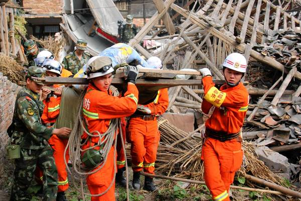 Rescuers carry an elderly man from his damaged home after an earthquake shook the Chinese city of Yaan and surrounding areas.