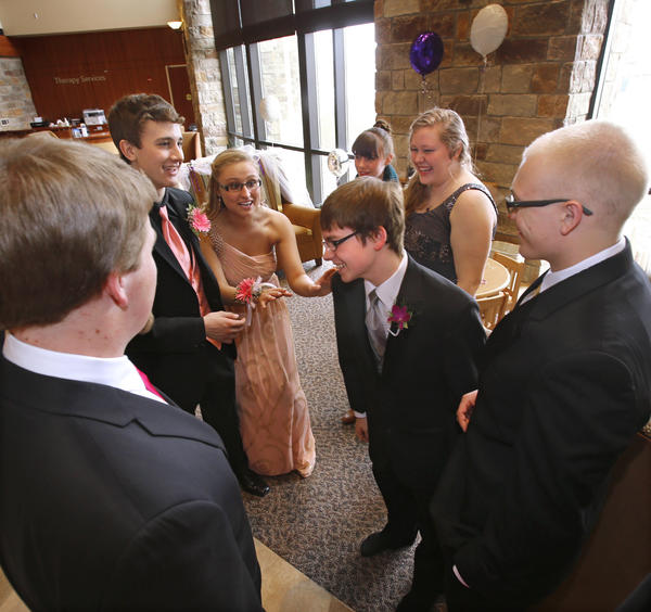 Patrick Dawn, center, shares a laugh with his friends, clockwise from the left: Seth Trautman, Jordan Gooding, Amanda Wagemann, Abi Whillock, Annie Compton and Justen Gelling, as they had an informal prom Saturday for Dawn in the lobby at Sanford Aberdeen Medical Center. Dawn had emergency surgery earlier this week and was unable to leave the hospital and attend the prom with his classmates at Aberdeen Central High School. American News Photo by John Davis