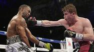 Canelo Alvarez brings it home to unify titles