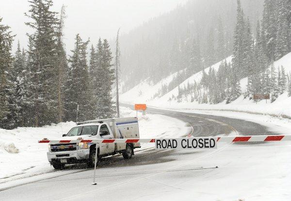 U.S. Route 6 at Loveland Pass, Colo., elevation 11,990 feet, is closed by the Colorado Department of Transportation near Loveland Ski Area after five backcountry snowboarders were killed in an avalanche.
