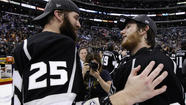The defending Stanley Cup champion Kings officially clinched a playoff spot -- and a chance to become the first team to win back-to-back titles since 1998 -- when the Detroit Red Wings lost to the Vancouver Canucks in a shootout Saturday night in Vancouver.