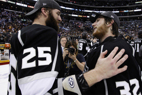 The Kings -- including Dustin Penner , left, and Jonathan Quick, shown after the Kings clinched the Stanley Cup last June -- will have to start working on their playoff beards again.