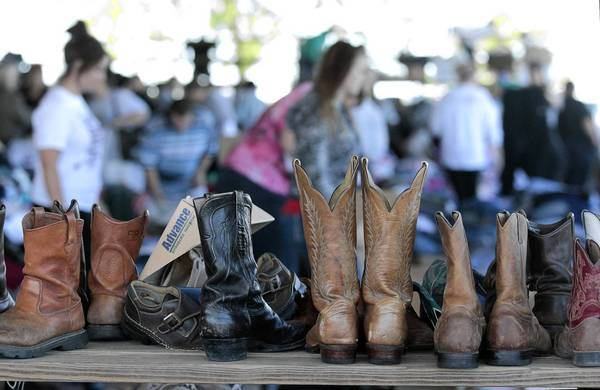 Boots are among the items donated to West, Texas, residents coping in the aftermath of Wednesday's fertilizer plant explosion.