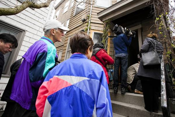 People visit the Tsarnaev home in Cambridge, Mass. Brothers Tamerlan and Dzhokhar Tsarnaev are suspected in the Boston Marathon bombings.