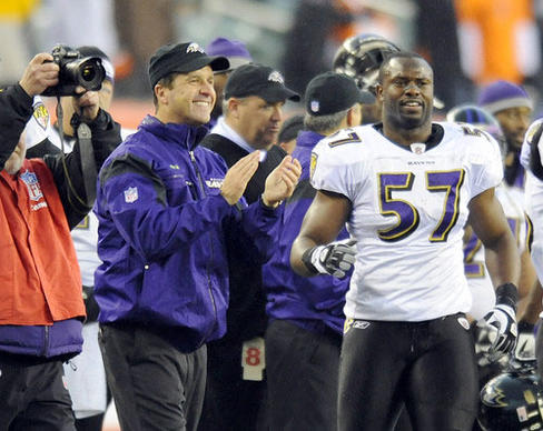 Ravens coach John Harbaugh and linebacker Bart Scott celebrate the team's 34-3 win over the Bengals.
