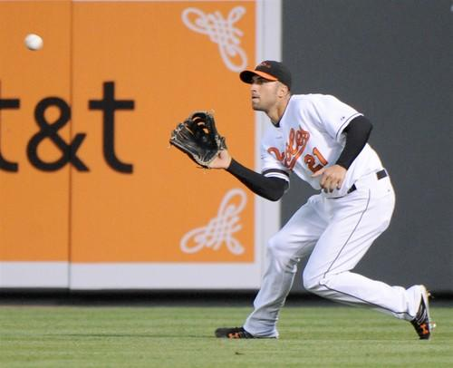 Nick Markakis makes a running catch in right center on a line drive from Miguel Cabrera for the last out of the fourth inning. The Orioles beat the Detroit Tigers 11-10 in 10 innings.