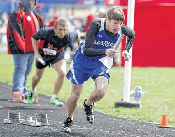 Marian's Andrew Guinan runs the lead leg in the Class B 800-meter relay Saturday at the Goshen Relays.
