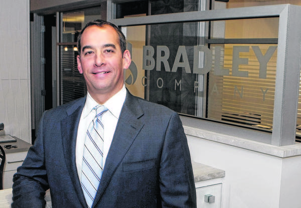 Brad Toothaker, president and CEO of Bradley Co., stands in the real estate firm's headquarters in downtown South Bend.