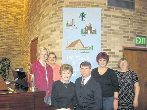 Carolyn Hoffman, from left, Carolyn Darlene Wesolek, Jean Wurzburger, the Rev. Scott Bowie, Sharan Dale, and Sandy Villwock are a members of the sesquicentennial planning committee for St. Peters United Church of Christ.