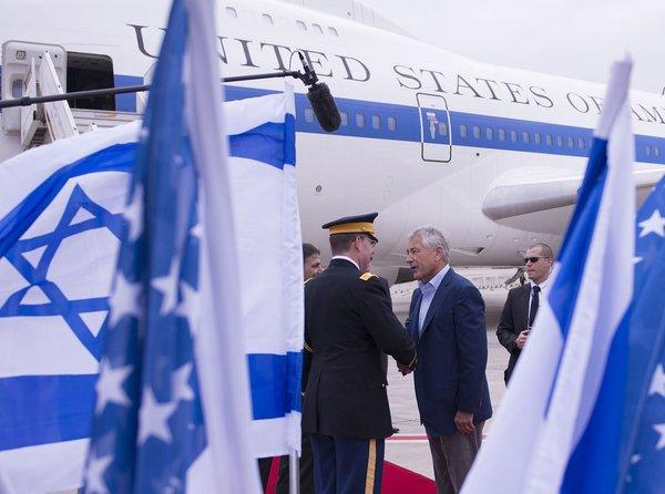 Secretary of Defense Chuck Hagel shakes hands with dignitaries as he arrives in Tel Aviv.
