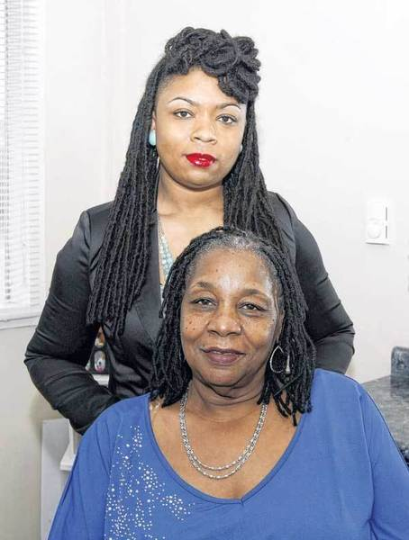 "Here is the new me, along with Akesma ""Keys"" McGlown, who is a licensed cosmetologist and loctician from Salon Envisions. Locs are her passion, McGlown said. Here we are after she performed my hair makeover."