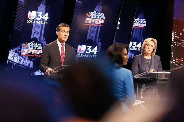 Los Angeles mayoral candidates Eric Garcetti and Wendy Greuel face off in a debate televised live from Spanish-language station KMEX.