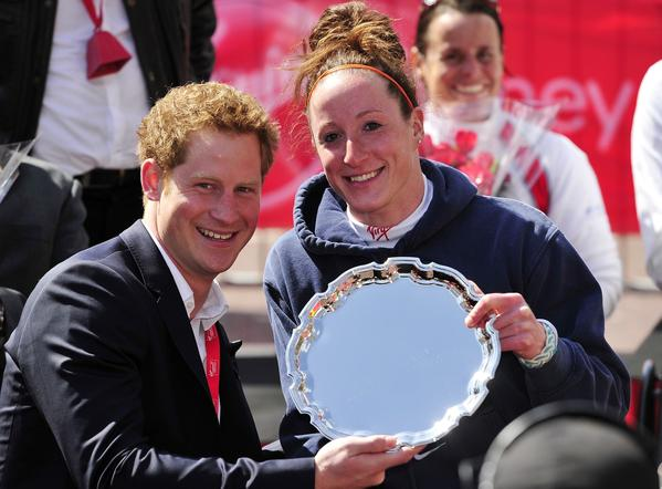 Tatyana McFadden of the US poses with Britain's Prince Harry after winning the women's wheelchair race in the 2013 London Marathon in London on April 21, 2013. American Tatyana McFadden claimed victory in the women's wheelchair event in a course record time to follow up her success in the equivalent race in Boston.
