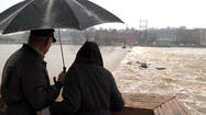 GRAND RAPIDS, Mich. (AP) — Hundreds of people have fled their homes in one of western Michigan's tallest residential buildings after water from the flooding Grand River poured into the basement of the Plaza Towers and Courtyard Marriott.