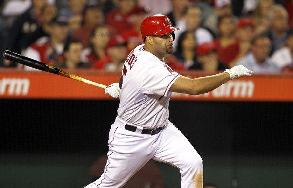 Angels first baseman Albert Pujols follows through on a single against Oakland early this month in Anaheim.