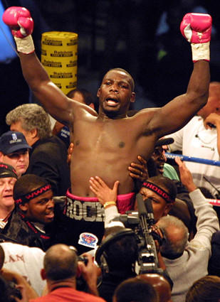 Hasim Rahman celebrates his victory over Lennox Lewis after their title fight at the Carnival City Areana outside Johannesburg, South Africa.