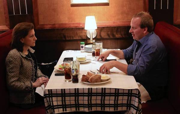 Lisa Pollina and Michael Soenen talk business over lunch at Gibsons Steakhouse.