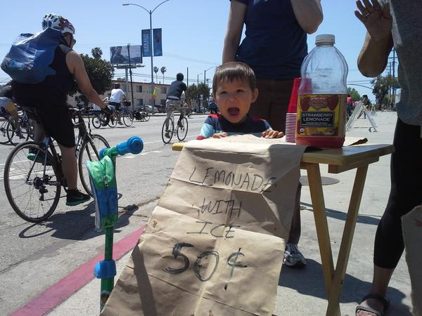 Marcus Wang, 2, at his lemonade stand set up for CicLAvia.