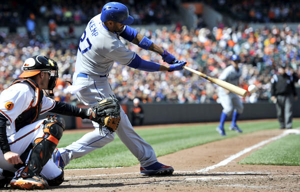Dodgers center fielder Matt Kemp connects for a run-scoring single against the Orioles in the fifth inning Sunday afternoon in Baltimore.