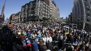 "BOSTON -- The Boston Marathon's finish line, a site of tragedy six days ago, became a place of worship Sunday afternoon as those attending an interfaith gathering set about ""reconsecrating"" the street."
