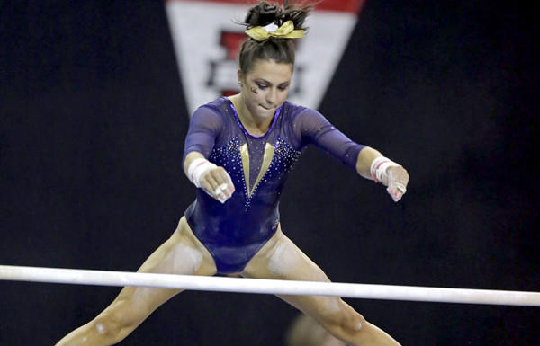 Louisiana State's Rheagan Courville competes in the unevenl bars in the NCAA women's gymnastics championships at Pauley Pavilion.