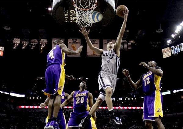 San Antonio Spurs guard Manu Ginobili drives to the basket past four Lakers.