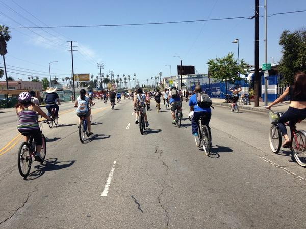 Cyclists make their way down Venice Boulevard on Sunday.