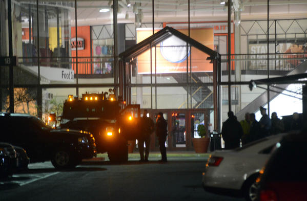 olice set up a perimeter outside the Arsenal Mall as they pursue possible suspects following a spate of shootings on April 19, 2013 in Watertown, Massachusetts. Earlier, a Massachusetts Institute of Technology campus police officer was shot and killed at the school's campus in Cambridge.