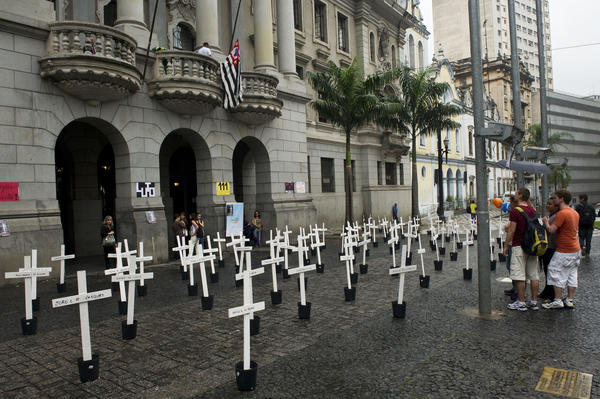 Crosses are seen in front of the School of Law of the University of Sao Paulo (USP) in homage to the inmates dead at the Carandiru Penitentiary massacre in Sao Paulo, Brazil on April 8, 2013. Twenty-six military police officers were to go on trial here Monday for the alleged execution-style killing of inmates during Brazil's deadliest prison uprising, which claimed the lives of 111 prisoners.